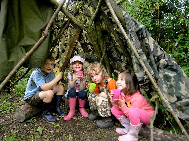 forest school kids in shelter