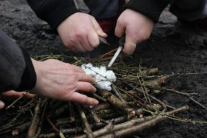 Making fires at the Teenage Woodland Programme encourages team building and confidence